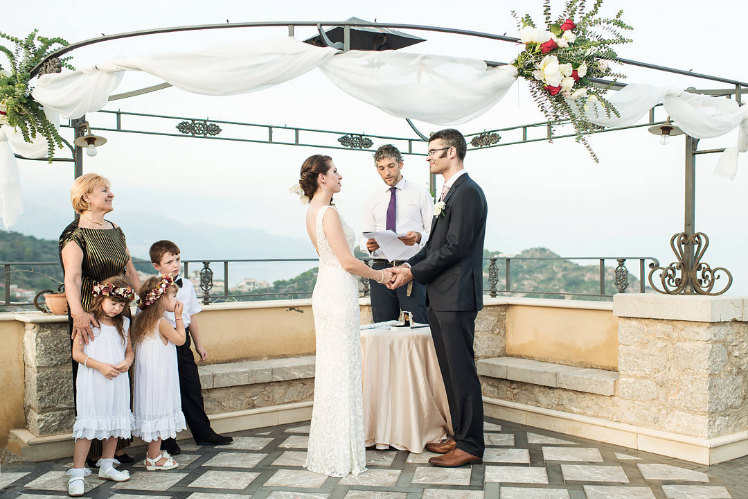 wedding ceremony on terrace over sea